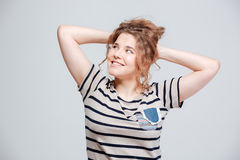 Mujer sonriente que mira lejos Imágenes de archivo libres de regalías