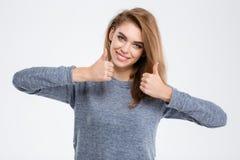 Mujer sonriente que muestra los pulgares para arriba Fotografía de archivo