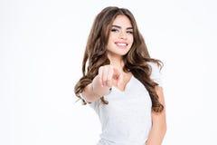 Mujer sonriente que señala el finger en la cámara Imagen de archivo