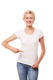 Mujer sonriente que señala en la camiseta blanca en blanco Fotos de archivo