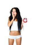 Mujer soñolienta con la alarma Imágenes de archivo libres de regalías