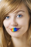 Mujer sorprendida con el lápiz labial del rainow Fotos de archivo