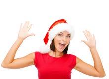 Mujer sorprendida en sombrero del ayudante de santa Foto de archivo libre de regalías
