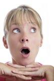 Mujer sorprendida que mira para arriba fotos de archivo