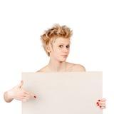 Mujer sorprendida que señala a bordo Fotos de archivo libres de regalías
