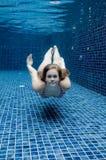 Mujer subacuática Fotos de archivo