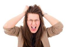 Mujer subrayada que tira de su pelo en la frustración Fotos de archivo libres de regalías