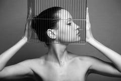 Mujer surrealista con la jaula Foto de archivo libre de regalías