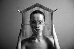 Mujer surrealista con la jaula Fotografía de archivo