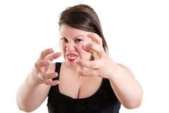Mujer temperamental furiosa que agarra sus manos imagen de archivo