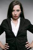 Mujer terminante en chaqueta negra Imagen de archivo