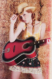 Mujer tres de la guitarra fotografía de archivo