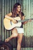 Mujer tres de la guitarra imagenes de archivo