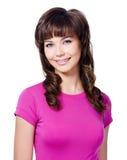 Mujer triguena alegre en camiseta color de rosa Imagen de archivo libre de regalías