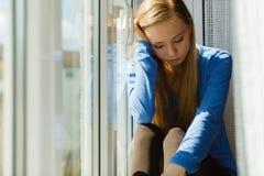 Mujer triste adolescente joven Imagen de archivo libre de regalías