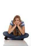 Mujer triste adolescente que se sienta en el piso Foto de archivo libre de regalías