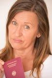 Mujer triste con el pasaporte alemán fotos de archivo