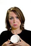 Mujer triste con la taza de café vacía fotos de archivo
