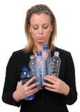 Mujer triste con las botellas vacías Fotos de archivo libres de regalías