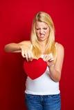 Mujer triste con un corazón Imagen de archivo