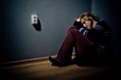 Mujer triste que se sienta solamente Imágenes de archivo libres de regalías