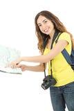 Mujer turística caucásica que señala en el mapa imagen de archivo libre de regalías