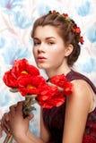 Mujer ucraniana con la flor Imagen de archivo