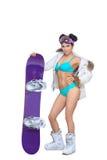 Mujer vestida atractiva con la snowboard Fotografía de archivo libre de regalías
