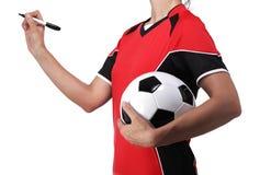 Mujer vestida en la escritura del fútbol algo Fotografía de archivo