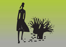Mujer y árbol silueteados Foto de archivo