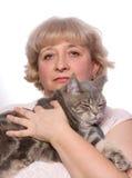 Mujer y animal doméstico foto de archivo