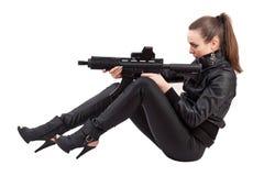 Mujer y arma Foto de archivo libre de regalías