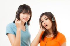 Mujer y auricular asiáticos Fotografía de archivo libre de regalías