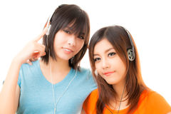Mujer y auricular asiáticos Fotos de archivo