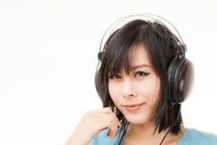 Mujer y auricular asiáticos Fotografía de archivo