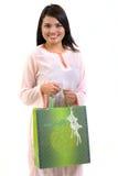 Mujer y bolso de compras Foto de archivo libre de regalías