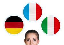Mujer y burbujas con las banderas de países Imágenes de archivo libres de regalías