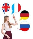 Mujer y burbujas con las banderas de países Fotos de archivo