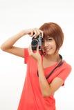 Mujer y cámara asiáticas Imagenes de archivo