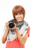 Mujer y cámara asiáticas Foto de archivo libre de regalías