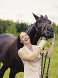 Mujer y caballo Fotografía de archivo