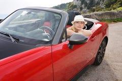 Mujer y cabriolé rojo Imágenes de archivo libres de regalías