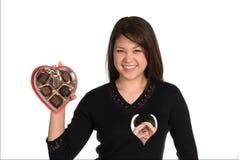 Mujer y caramelo de las tarjetas del día de San Valentín Fotos de archivo