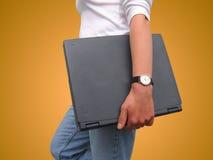 Mujer y computadora portátil Foto de archivo libre de regalías