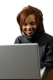 Mujer y computadora portátil Fotografía de archivo libre de regalías