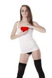 Mujer y corazón rojo artificial Foto de archivo libre de regalías