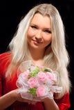 Mujer y flores Imagen de archivo