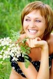 Mujer y flores Imagen de archivo libre de regalías