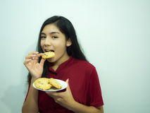 Mujer y galletas asiáticas Fotografía de archivo