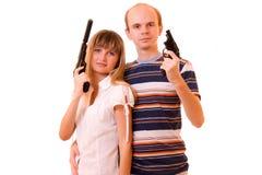 Mujer y hombre con los armas Fotos de archivo libres de regalías